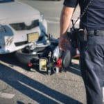 Cop walking toward motorcycle accident