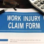 Blank work injury claim form on desk