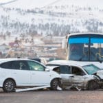 Two cars crash into bus in an accident